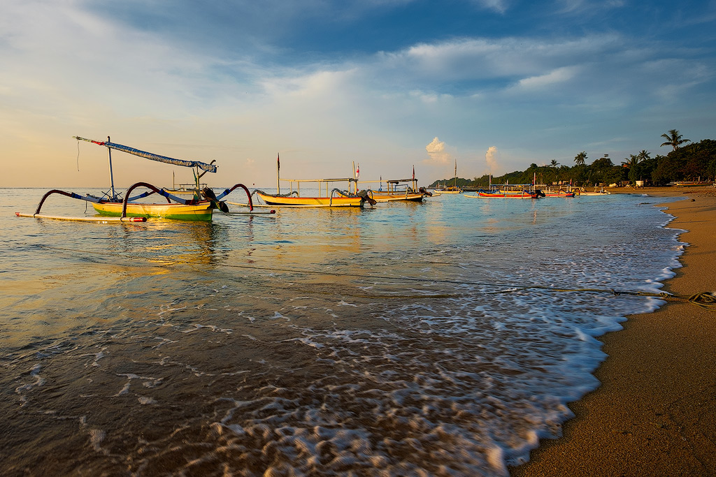 Traditional fishing boats called Jukung at dawn in Sanur - Bali